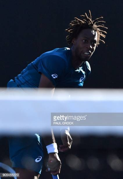 France's Gael Monfils serves to Spain's Jaume Munar during their men's singles first round match on day two of the Australian Open tennis tournament...