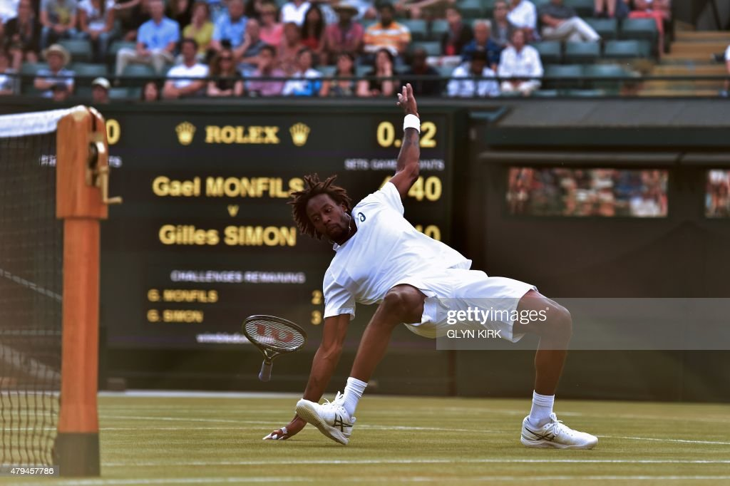 France's Gael Monfils slips during a point against France's Gilles Simon during their men's singles third round match on day six of the 2015 Wimbledon Championships at The All England Tennis Club in Wimbledon, southwest London, on July 4, 2015. RESTRICTED