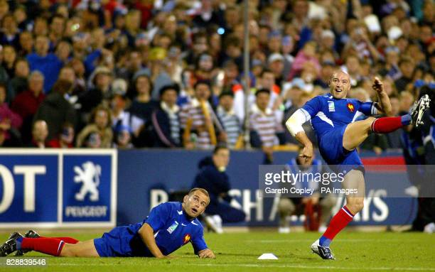 France's Gerald Merceron takes a kick watched by teammate Yannick Bru during their Rugby Union World Cup pool match at WIN Stadium Wollongong NO...