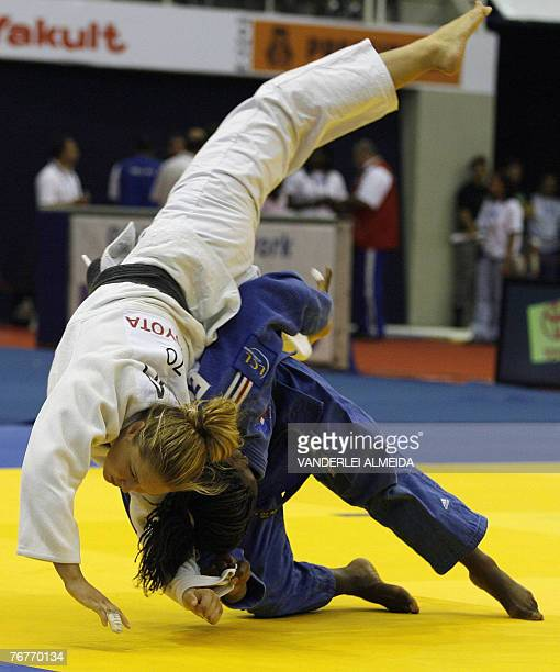France's Gevrise Emane fights with USA's Ronda Rousey during the woman's plus 70kg category at the 25th World Judo Championship in Rio de Janeiro 14...