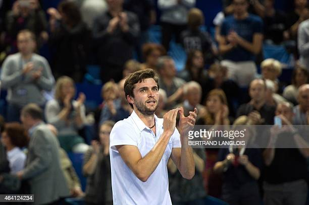 France's Gilles Simon celebrates winning against France's Gael Monfils after the Open 13 tennis final match in Marseille, southern France, on...
