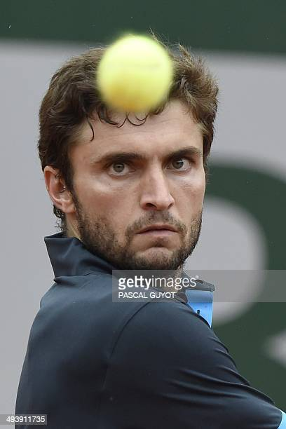 France's Gilles Simon eyes the ball during his French tennis Open first round match against Croatia's Ante Pavic at the Roland Garros stadium in...