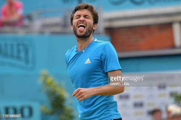 France's Gilles Simon gestures against Spain's Feliciano Lopez in their men's singles final tennis match at the ATP Fever-Tree Championships...