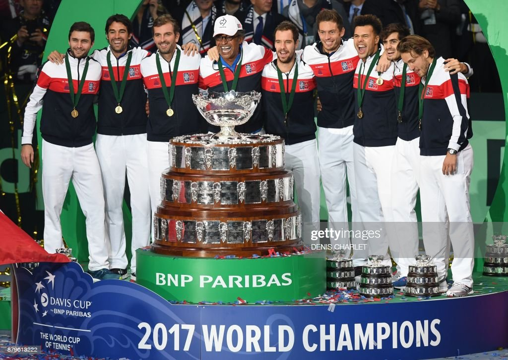 France's Gilles Simon, Jeremy Chardy, Julien Benneteau, Yannick Noah, Richard Gasquet, Nicolas Mahut, Jo-Wilfried Tsonga Pierre-Hugues Herbert and Lucas Pouille pose with the trophy after winning the Davis Cup World Group final tennis match between France and Belgium at The Pierre Mauroy Stadium in Villeneuve d'Ascq near Lille on November 26, 2017. / AFP PHOTO / Denis Charlet