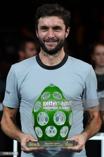 France's Gilles Simon poses with his trophy after winning the ATP Moselle Open final tennis match on September 23, 2018 in Metz, eastern France.