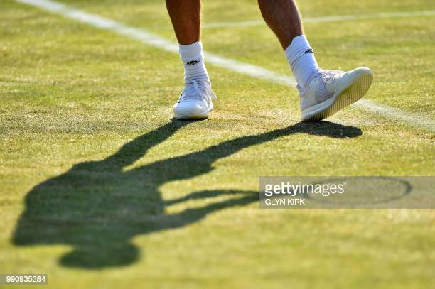 France's Gilles Simon prepares to serve against Georgia's Nikoloz Basilashvili during their men's singles first round match on the second day of the...