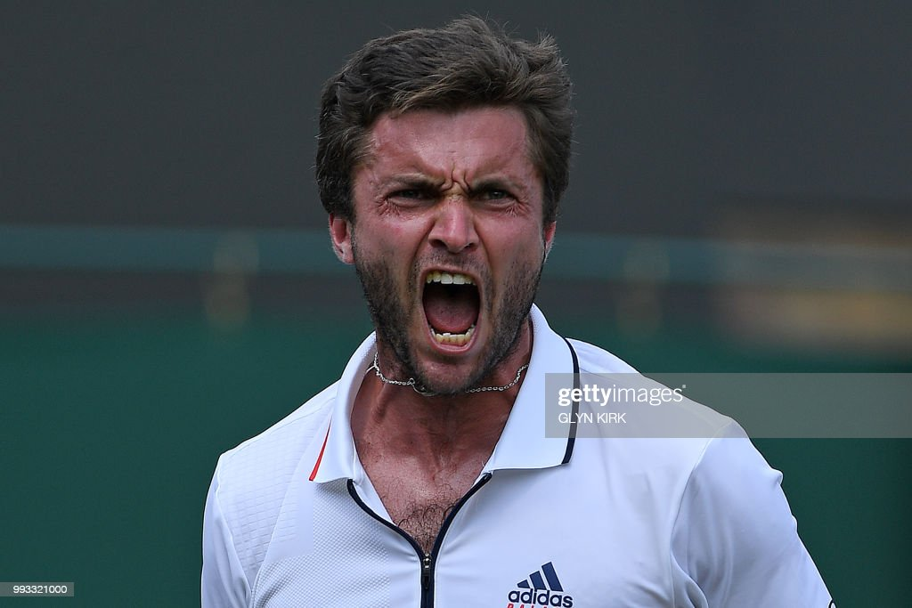 TOPSHOT - France's Gilles Simon reacts after winning against Australia's Matthew Ebden during their men's singles third round match on the sixth day of the 2018 Wimbledon Championships at The All England Lawn Tennis Club in Wimbledon, southwest London, on July 7, 2018. (Photo by Glyn KIRK / AFP) / RESTRICTED