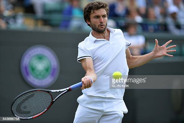 France's Gilles Simon returns against Bulgaria's Grigor Dimitrov during their men's singles second round match on the fourth day of the 2016...