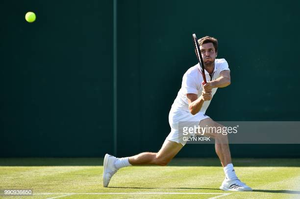 France's Gilles Simon returns against Georgia's Nikoloz Basilashvili during their men's singles first round match on the second day of the 2018...