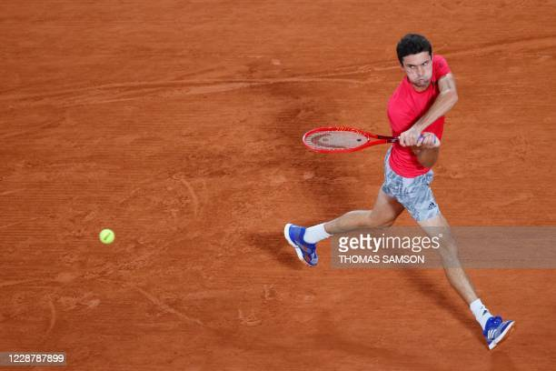 France's Gilles Simon returns the ball to Canada's Denis Shapovalov during their men's singles first round tennis match at the Philippe Chatrier...
