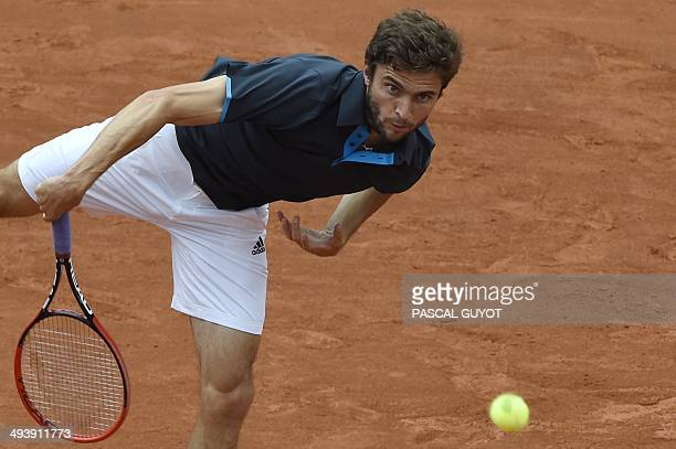 France's Gilles Simon returns the ball to Croatia's Ante Pavic during their French tennis Open first round match at the Roland Garros stadium in...