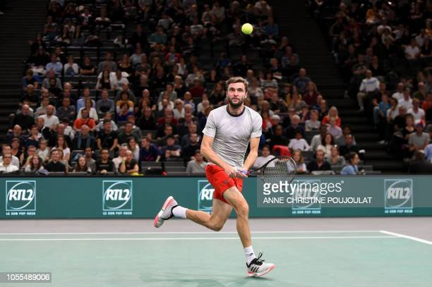 France's Gilles Simon returns the ball to France's Lucas Pouille during their men's singles first round match on day two of the ATP World Tour...