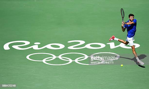 TOPSHOT France's Gilles Simon returns the ball to Spain's Rafael Nadal during their men's singles third round tennis match at the Olympic Tennis...