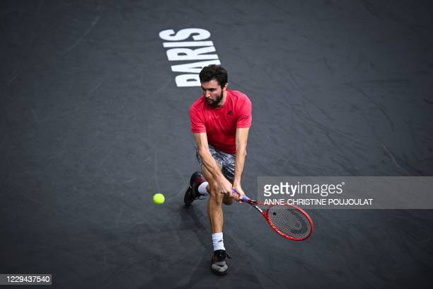 France's Gilles Simon returns the ball to Tommy Paul of the US during their men's singles first round tennis match on day 2 at the ATP World Tour...