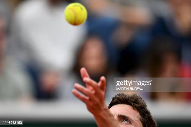 France's Gilles Simon serves the ball to Italy's Salvatore Caruso during their men's singles second round match on day five of The Roland Garros 2019...