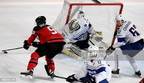 France's goalkeeeper Florian Hardy vies with Canada's forward Matt Duchene during the IIHF Mens World Championship group B ice hockey match Canada vs...