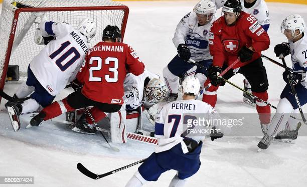 TOPSHOT France's goalkeeeper Florian Hardy vies with Switzerland's forward Simon Bodenmann during the IIHF Men's World Championship group B ice...