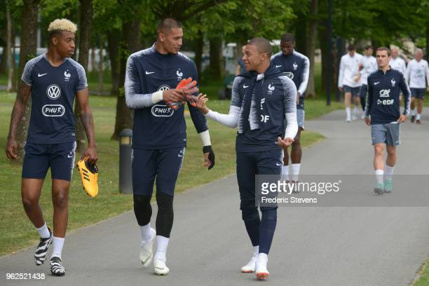 France's goalkeeper Alphonse Areola and Kylian Mbappe arrive to a training session at the French national football team centre in...