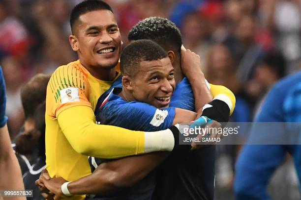 France's goalkeeper Alphonse Areola France's forward Kylian Mbappe and France's defender Presnel Kimpembe celebrate at the end of the Russia 2018...