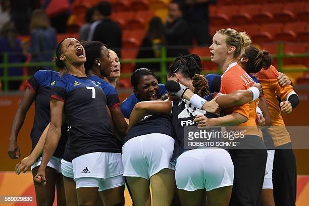 TOPSHOT France's goalkeeper Amandine Leynaud France's left back Allison Pineau and teammates celebrate their victory at the end of the women's...