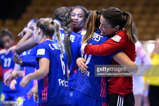 France's goalkeeper Cleopatre Darleux celebrates with teammates after their team's 30-19 win after the semi-final match between France and Croatia of...
