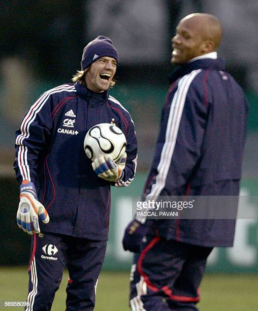 France's goalkeeper Gregory coupet jokes with defender JeanAlain Boumsong during a training session 27 February 2006 in the French football National...