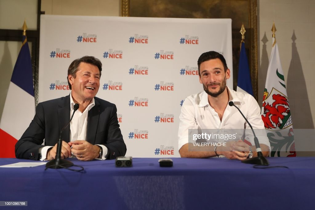 France's goalkeeper Hugo Lloris (R) and Nice's mayor Christian Estrosi smile during a press conference in Lloris' home town of Nice, southeastern France, on July 18, 2018 three days after French players won the Russia 2018 World Cup final football match.
