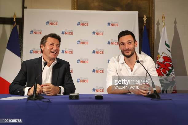 France's goalkeeper Hugo Lloris and Nice's mayor Christian Estrosi smile during a press conference in Lloris' home town of Nice southeastern France...