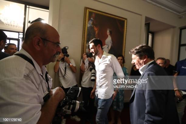 France's goalkeeper Hugo Lloris and Nice's mayor Christian Estrosi leave after a press conference in Lloris' home town of Nice southeastern France on...