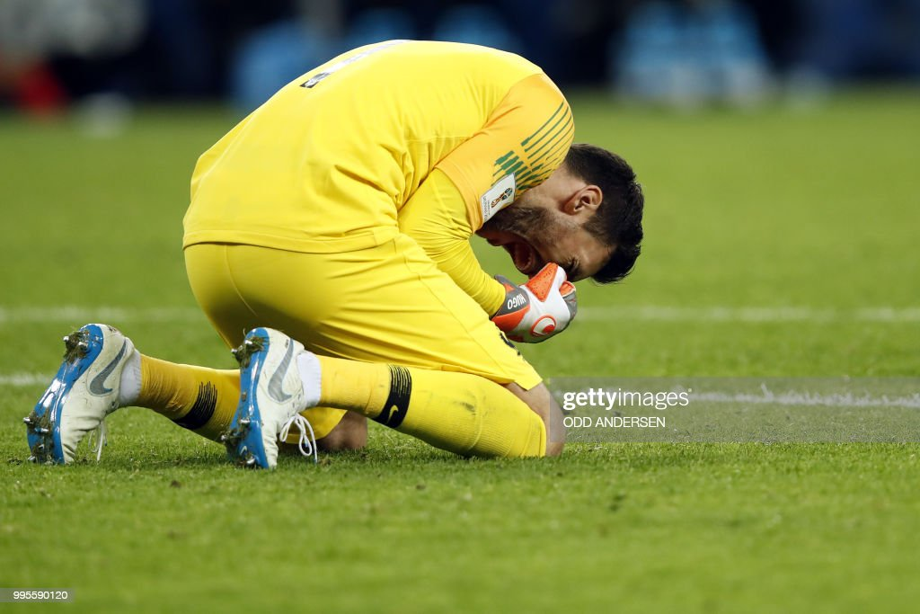France's goalkeeper Hugo Lloris celebrates their victory at the end of the Russia 2018 World Cup semi-final football match between France and Belgium at the Saint Petersburg Stadium in Saint Petersburg on July 10, 2018. (Photo by Odd ANDERSEN / AFP) / RESTRICTED