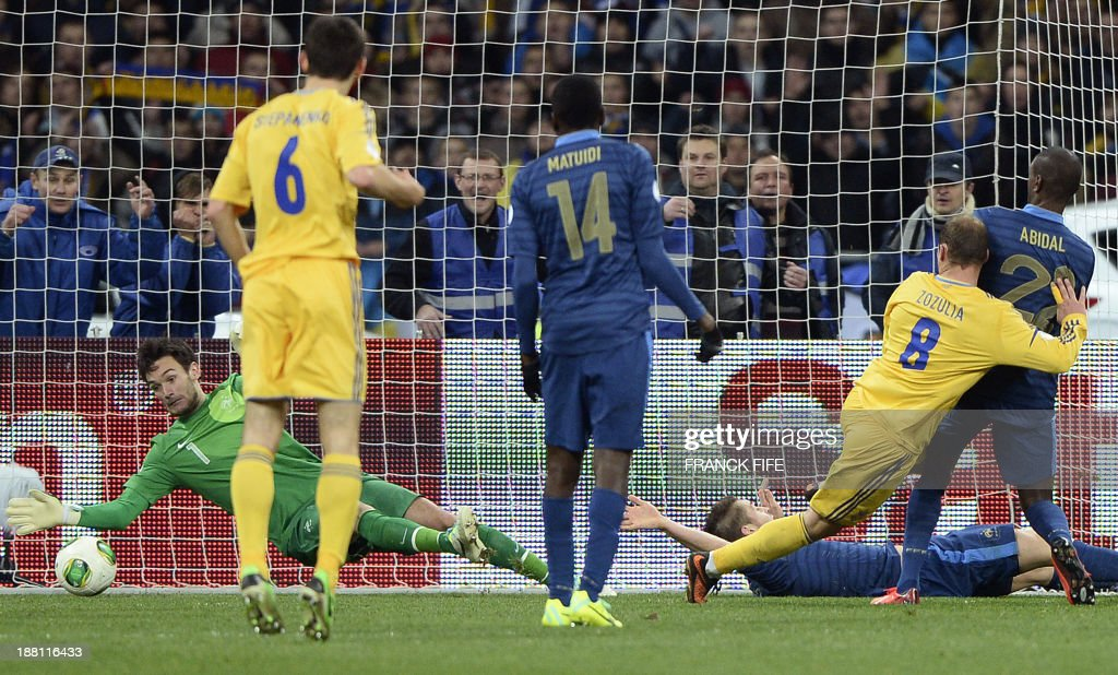 France's goalkeeper Hugo Lloris (L) concedes a goal to Ukraine's forward Roman Zozulia (2nd-R) during the 2014 FIFA World Cup qualifying play-off first leg football match between Ukraine and France at the Olympic Stadium in Kiev on November 15, 2013.