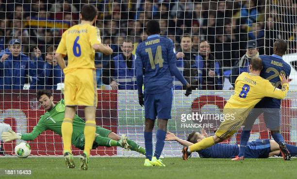 France's goalkeeper Hugo Lloris concedes a goal to Ukraine's forward Roman Zozulia during the 2014 FIFA World Cup qualifying playoff first leg...