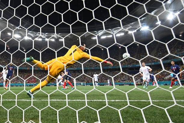 France's goalkeeper Hugo Lloris concedes the first goal during the UEFA EURO 2020 round of 16 football match between France and Switzerland at the...
