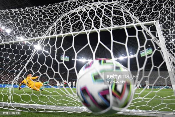 France's goalkeeper Hugo Lloris concedes the opening goal scored by Portugal's forward Cristiano Ronaldo from the penalty spot during the UEFA EURO...