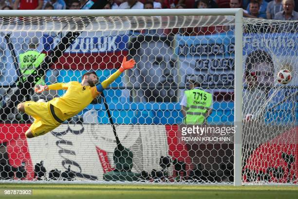 TOPSHOT France's goalkeeper Hugo Lloris dives and takes Argentina's first goal during the Russia 2018 World Cup round of 16 football match between...