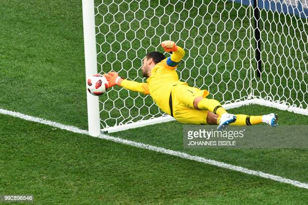 TOPSHOT France's goalkeeper Hugo Lloris dives to make a save during the Russia 2018 World Cup quarterfinal football match between Uruguay and France...