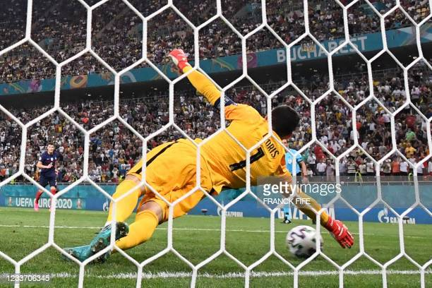 France's goalkeeper Hugo Lloris dives to save a penalty during the UEFA EURO 2020 round of 16 football match between France and Switzerland at the...