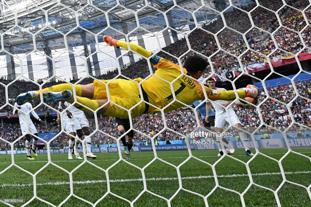 France's goalkeeper Hugo Lloris dives to stop the ball during the Russia 2018 World Cup quarter-final football match between Uruguay and France at the Nizhny Novgorod Stadium in Nizhny Novgorod on July 6, 2018. (Photo by FRANCK FIFE / AFP) / RESTRICTED