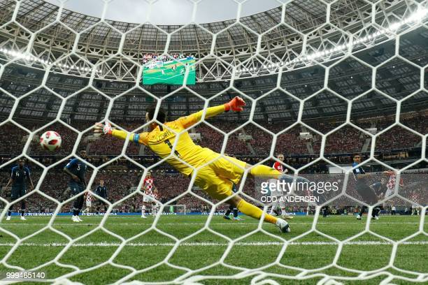 France's goalkeeper Hugo Lloris fails to save Croatia's forward Ivan Perisic's equalizer during the Russia 2018 World Cup final football match...