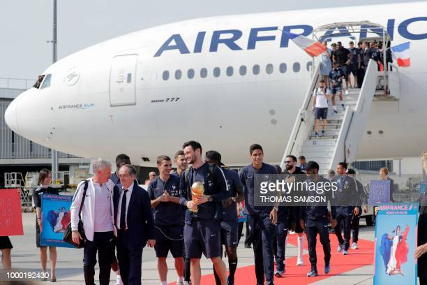 France's goalkeeper Hugo Lloris flanked by France's coach Didier Deschamps French Football Federation president Noel Le Graet France's forward...