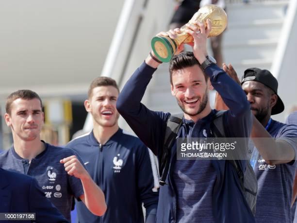 TOPSHOT France's goalkeeper Hugo Lloris flanked by France's forward Antoine Griezmann France's defender Lucas Hernandez and France's defender Samuel...