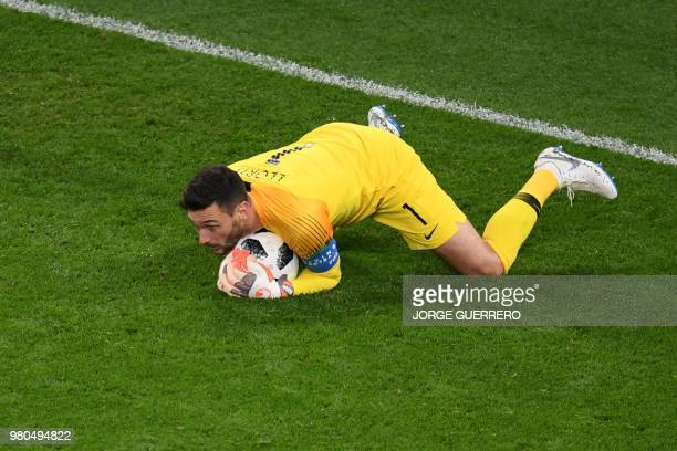 TOPSHOT France's goalkeeper Hugo Lloris gathers the ball during the Russia 2018 World Cup Group C football match between France and Peru at the...