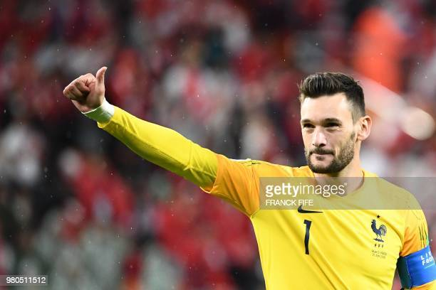 France's goalkeeper Hugo Lloris gestures as he celebrates after winning prior to the Russia 2018 World Cup Group C football match between France and...