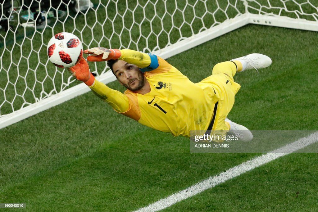 TOPSHOT - France's goalkeeper Hugo Lloris jumps to catch the ball during the Russia 2018 World Cup semi-final football match between France and Belgium at the Saint Petersburg Stadium in Saint Petersburg on July 10, 2018. (Photo by Adrian DENNIS / AFP) / RESTRICTED
