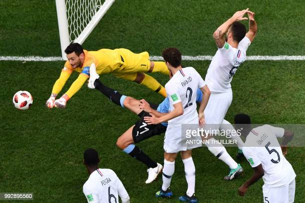 TOPSHOT France's goalkeeper Hugo Lloris punches the ball clear during the Russia 2018 World Cup quarterfinal football match between Uruguay and...
