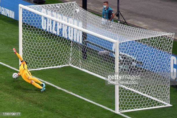 France's goalkeeper Hugo Lloris saves a penalty during the UEFA EURO 2020 round of 16 football match between France and Switzerland at the National...