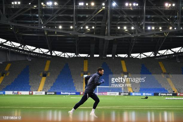 France's goalkeeper Hugo Lloris warms up prior to the FIFA World Cup Qatar 2022 qualification Group D football match between Kazakhstan and France,...