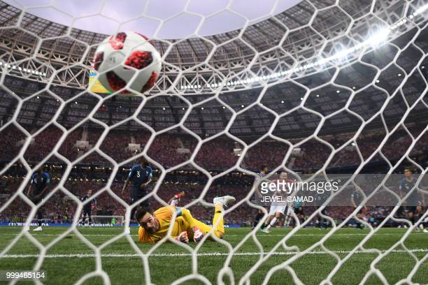 TOPSHOT France's goalkeeper Hugo Lloris watches the ball after conceding during the Russia 2018 World Cup final football match between France and...