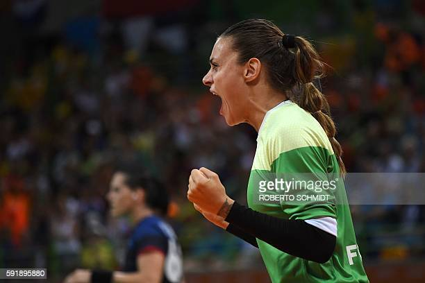 France's goalkeeper Laura Glauser reacts during the women's semifinal handball match Netherlands vs France for the Rio 2016 Olympics Games at the...