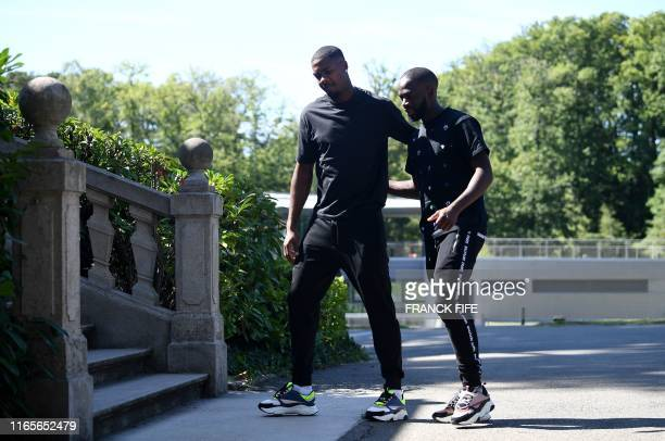 France's goalkeeper Mike Maignan and forward Jonathan Ikone arrive at the French national football team training base in Clairefontaine on September...